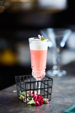 Blushing cranberry cocktail in a glass