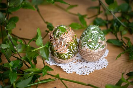 Forest themed Easter eggs decorated with natural leafs – holiday table decoration during celebration