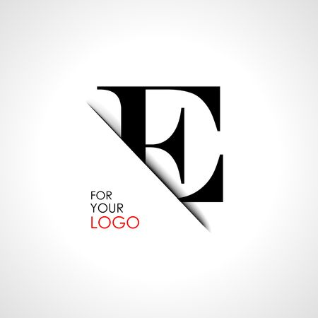 Capital e letter is inserted in the paper slot. To create logos, emblems, monograms