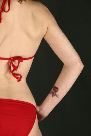 tatto: woman wearing a red bikini with a tatto on her arm