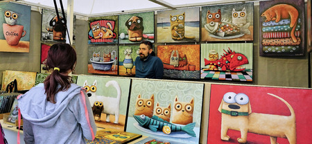 Vendor sells unique animal art in his market stall in Bratislava Slovakia Publikacyjne