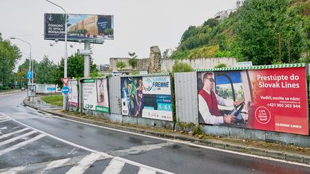 Bratislava, Slovakia - Aug 2018: Billboards line a highway on-ramp in Eastern Europe