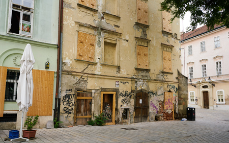 Bratislava, Slovakia - Aug 2018: Eastern European inner city decay is evident in the heart of old town where tourist gather.