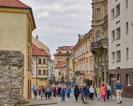 Bratislava, Slovakia - Aug 2018: Street scene in the old town with crowds of tourists heading down the shopping district pedestrian mall. Editorial