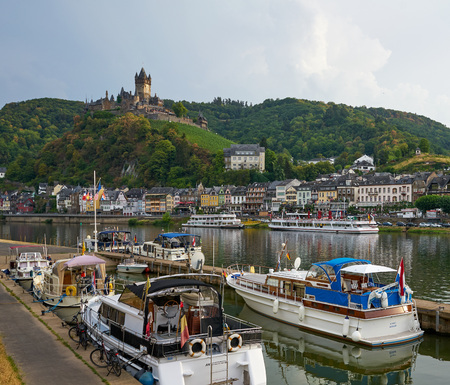 Cochem, Germany - Aug 2018: Moselle River with medieval town of Cochem with its Castle and numerous pleasure craft moored along the banks. Editorial