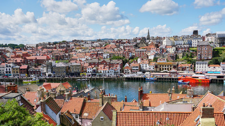 Red Tiled Roof Shops & Homes in Historic Whitby Harbour, England. Stock Photo