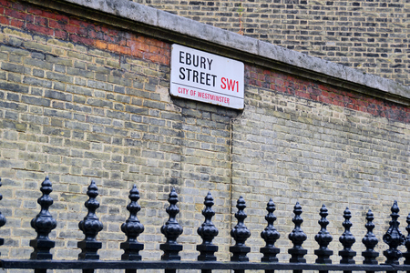 Classic Street Sign on old brick wall in New Westminster, England - Aug 2017 Editorial