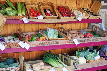 Market Stall filled with assortment of healthy vegetables - York, England - Aug 2017