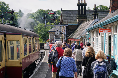 Tourists disembark  Vintage North Yorkshire Steam Railway in Whitby, England - Aug 2017
