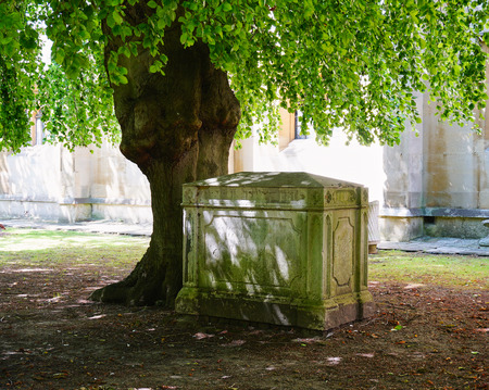Peaceful scene with old Tomb and Tree in Churchyard in Windsor, England - Aug 2017