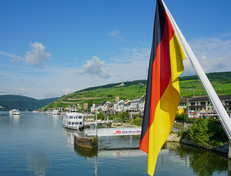 German Flag with Rudesheim, Germany in background - Aug 2016