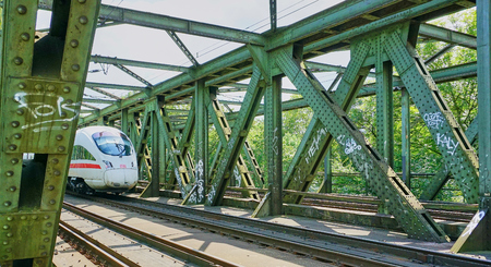 High Speed Inter-city Express Train (ICE TRAIN) crossing a steel train trestle - Frankfurt - Aug 2016
