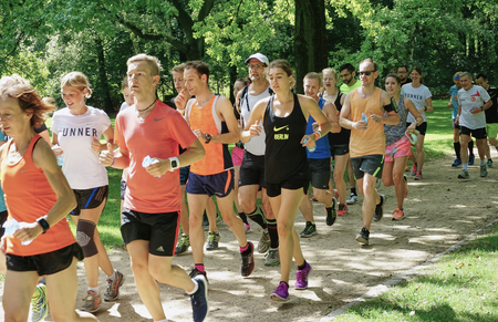 Group of Runners jogging through the Tiergarten park in Berlin, Germany - Aug 2016