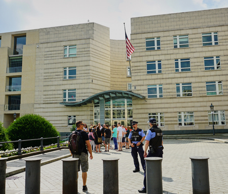 Man with backpack approaches guards at American Embassy in Berlin, Germany - Aug 2016