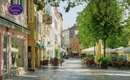 Sunny street scene of shops and cafes in Wiesbaden, Germany - Aug 2016
