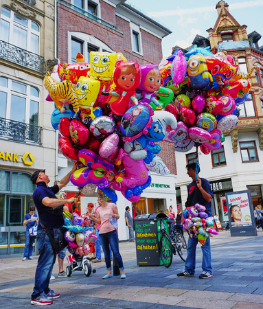 Men selling colorful balloons in Wiesbaden, Germany - Aug 2016 Editorial