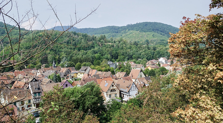 Elevated view of red tiled roof tops of medieval village in Alsace France, Keysersberg - Aug 2015 Banco de Imagens