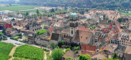 Elevated view down onto the medieval Alsatian village and surrounding countryside of Keysersberg on the wine route in eastern France.