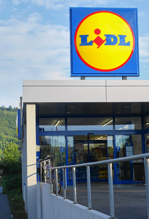 Koblenz, Germany - Aug 2015:  Iconic sign of the Lidl discount grocery chain on top of one of their stores on the Moselle River