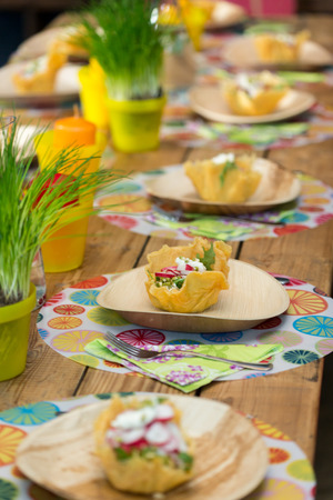 cheese basket with fresh radish salad on wooden plate Stock Photo
