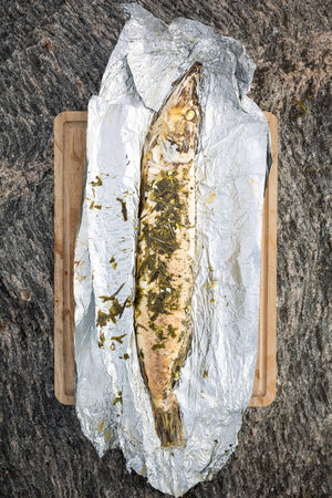 luce: grilled luce fish with salad and rosemary on foil
