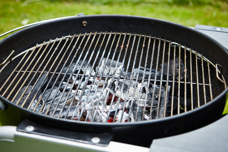 coals: closeup of charcoal in grill with grate Stock Photo