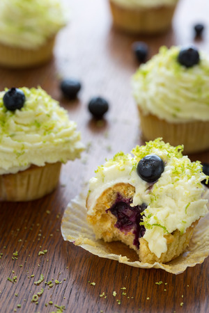 fill up: Blueberry cupcakes with creme, filling and lime. Stock Photo