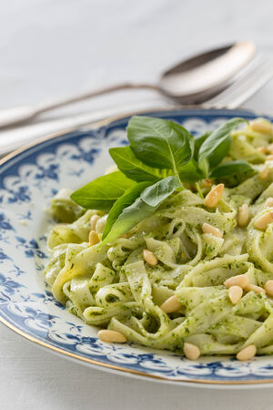 macaroni with pesto and pine nuts. Vertical image. photo