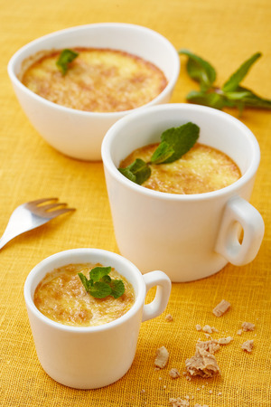 portions: three portions of cheese cream soup in white dishware Stock Photo