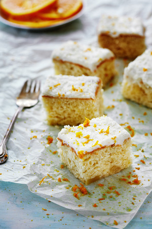 blondie: five squares of mandarine blondie cake on a piece of parchment Stock Photo