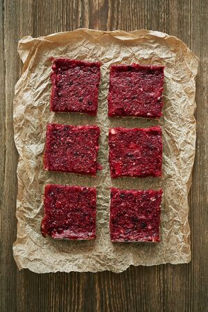 parchment: a top view of raspberry bars on the piece of parchment
