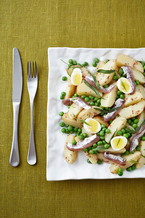 sprat: a top view of seafood salad served on the square plate Stock Photo