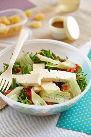 a portion of vegetable salad with Feta in a plastic bowl Stock Photo