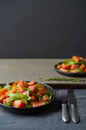dietetic: dietetic fruit and vegetable salad served in the plate in the dark background Stock Photo