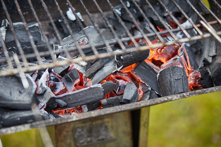 horizontal macro image of a brazier with ruddy charcoal Stock Photo