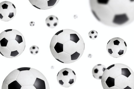 soccer ball sailing through on white background photo