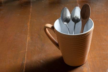 wood table: Coffee cup with spoon on wood table Stock Photo