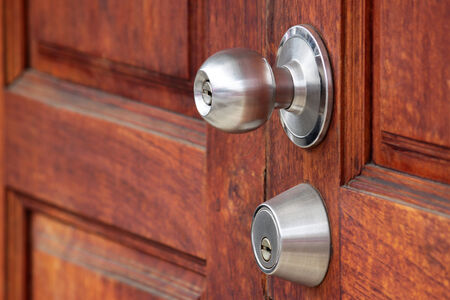 metal handle on a wooden door photo