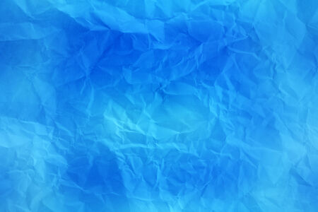 torn paper background: blue crumpled paper