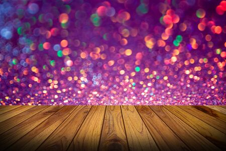 multi colors: bokeh lights background with multi colors with motion blur and wood floor Stock Photo
