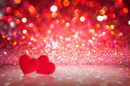 multi colors: bokeh lights background with multi colors with motion blur and red heart Stock Photo