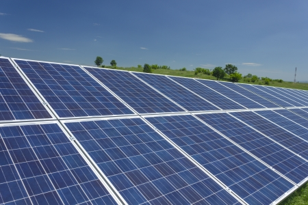 Electric photovoltaic solar panels cells on a field