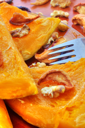 Baked pumpkin with dried fruits and nuts Stock Photo