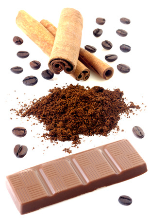 cannelle: Cinnamon with chocolate and coffee beans isolated