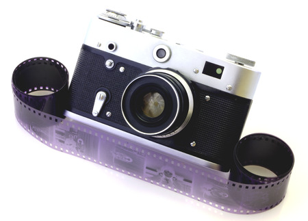 Retro camera and tape isolated on white photo