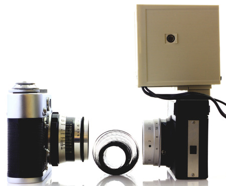 Retro cameras and flash isolated on white photo
