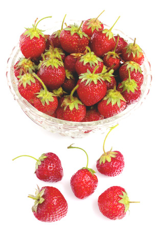 Strawberries in bowl isolated on white