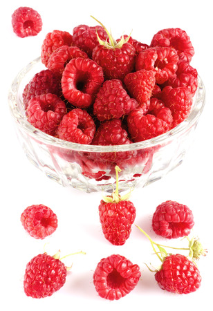 Raspberries in bowl isolated on white photo