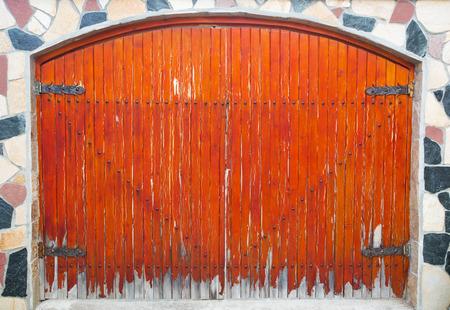 Stylish wooden door on stone wall photo