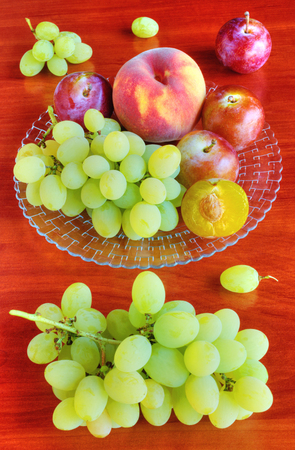 Fresh fruits on table photo